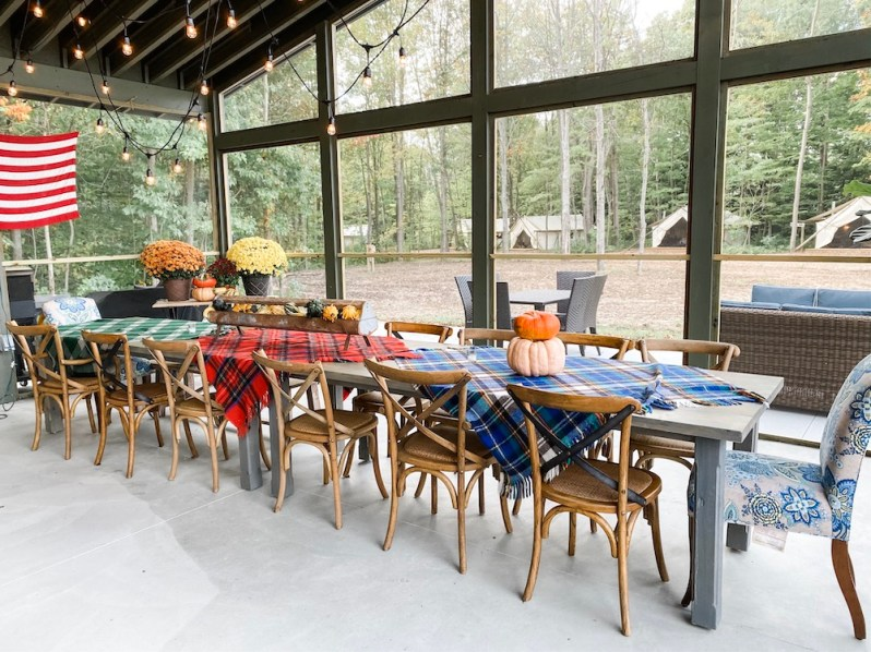 Long Dining Table Plaid Blanket Table Cloths String Lights Pumpkins