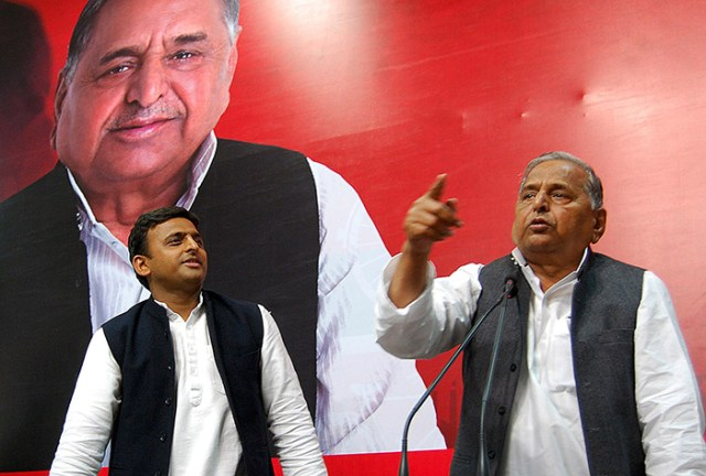 Samajwadi Party National President Mulayam Singh Yadav along with son Uttar Pradesh Chief Minister Akhilesh Yadav addressing a press conference at state party head quaters in Lucknow.