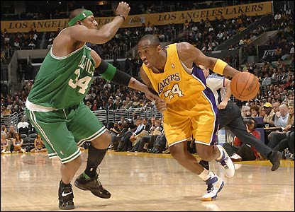 Laker's guard Kobe Bryant drives on Celtics guard Paul Pierce