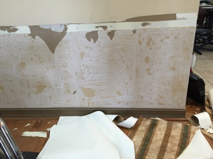 The wall paper in progress coming down and sans chair rail