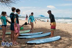 group-surf-lesson-on-beach