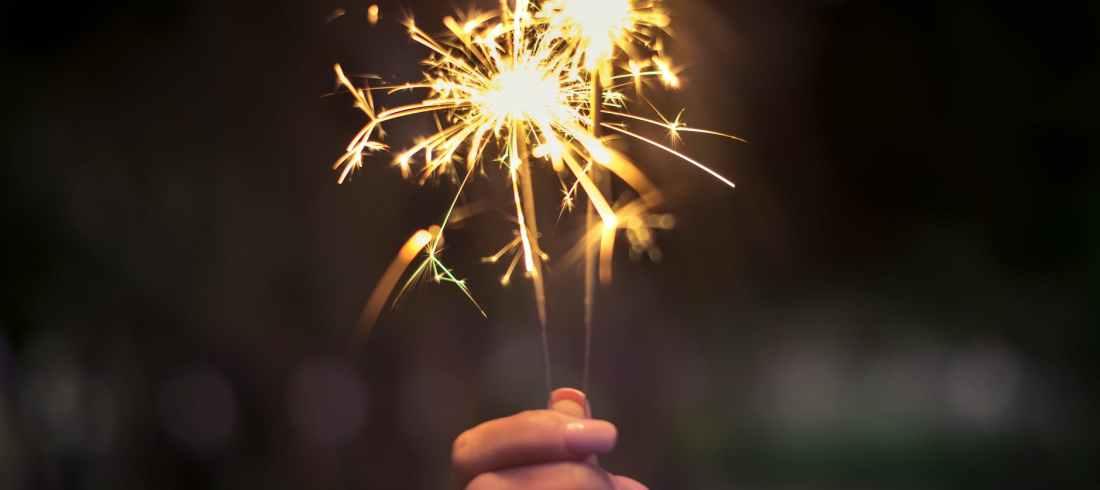 person holding lighted sparkler