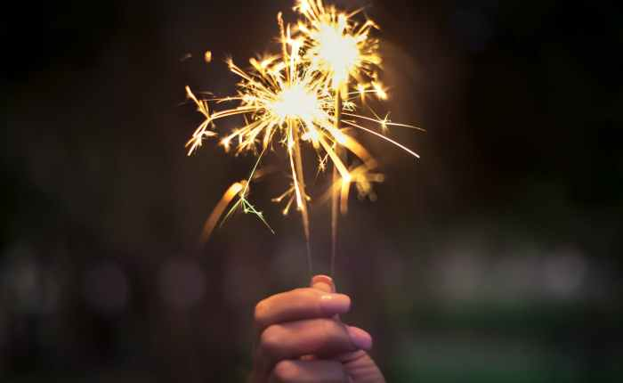 person holding lighted sparkler