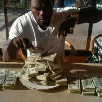Money Speaking!-50cent shows off stacks of dollars in place of food(Photos)