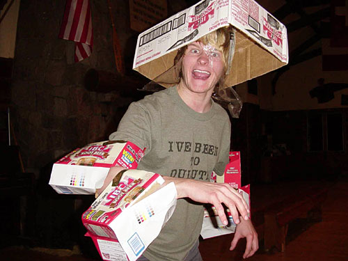 """Dane wearing his """"I've Been to Duluth"""" t-shirt, dressed up in IBC rootbeer cases, pretending he's a raptor"""
