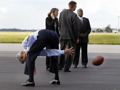 John Kerry playing football. Poorly.