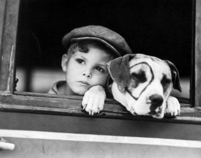 "ca. 1930 --- Dickie Moore and Pete the Pup start for location together while working in the 1932 film ""A Lad an' his Lamp,"" the new Hal Roach ""Our Gang"" comedy. --- Image by © Bettmann/CORBIS"
