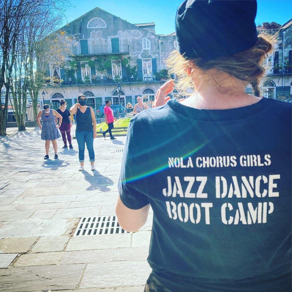 Amy Johnson teaching chorus girls outside in New Orleans, Louisiana.