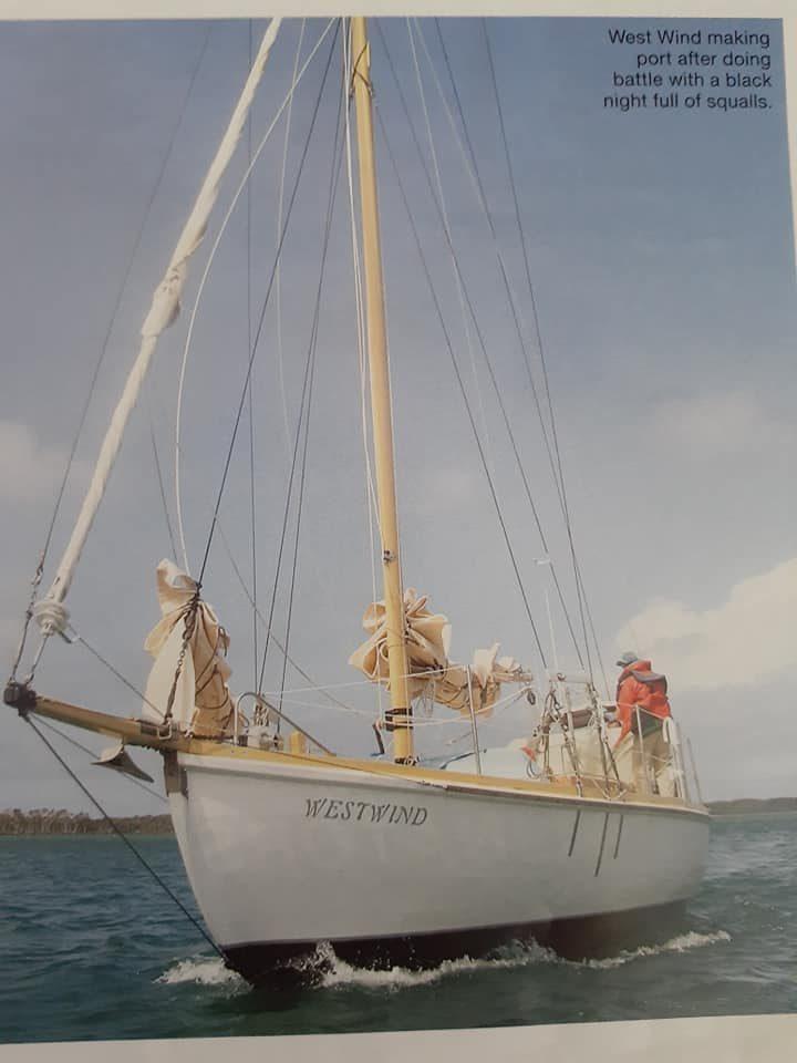 The beautiful girl a sleek sailing boat