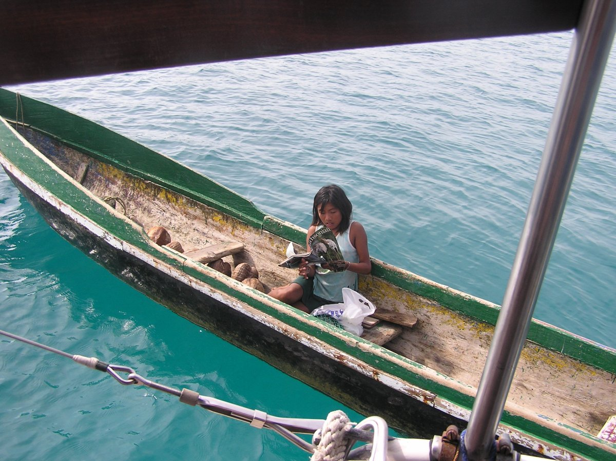 A beautiful young Kuna girl in The San Blas, grasping the magazine we have just gifted her