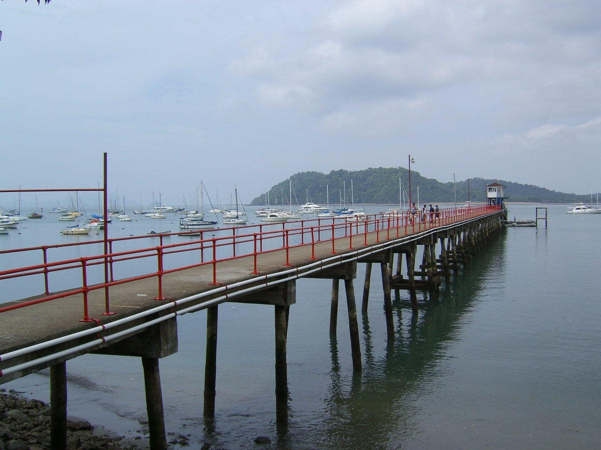 A large jetty with boats moored behind in Balboa, after transiting the Canal