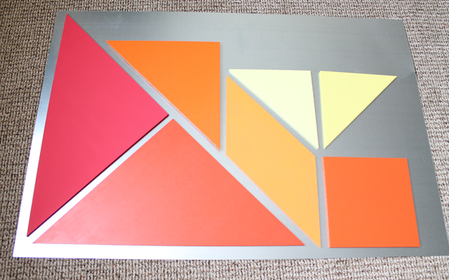 painted wooden tangrams