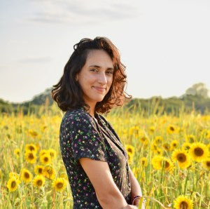 Profile photo of the author in a field of sunflowers