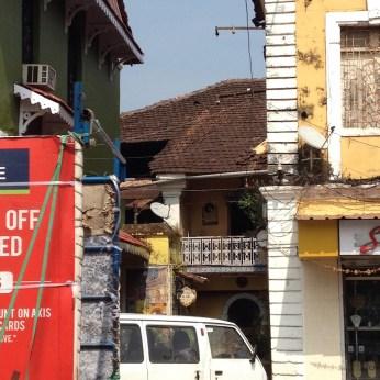 Traditional houses peeping between modern mayhem