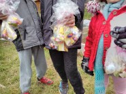 Isaac, jude and Kateland proudly show their sweet bounty at the Easter egg hunt