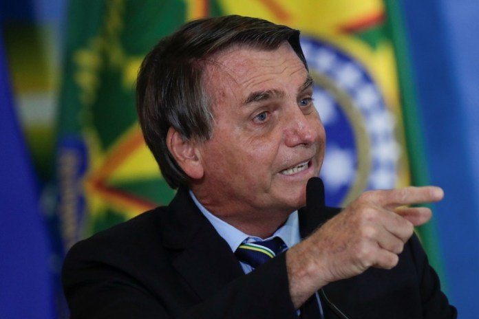Presidente Jair Bolsonaro em cerimônia no Palácio do Planalto no dia 12 de maio — Foto: Ueslei Marcelino/Reuters
