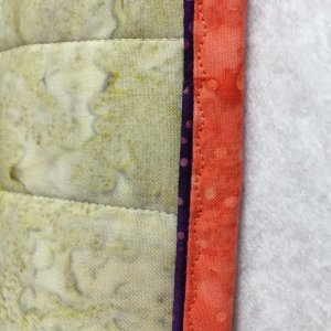 Binding in a contrasting color.