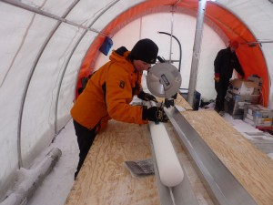 Liz Thomas measuring an ice core in the field. Credit: Liz Thomas