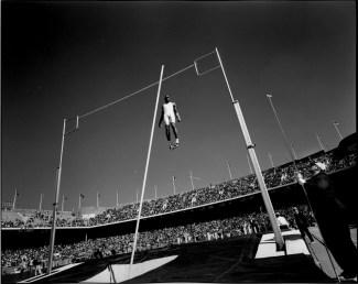 Penn Relays, University of Pennsylvania's Franklin Field, Philadelphia, 1996 Burnett catches 1990s champion pole-vaulter Lawrence Johnson (aka LoJo) as he clears the bar.