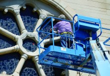 Mike Delva of Denver Art Glass repaired the damaged leaded windows and will install protective glass over the main-level windows this fall.