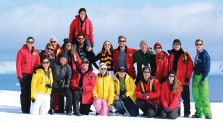 The CC group poses Jan. 1 on Cuverville Island on a ridge overlooking the Antarctic peninsula. From left, front row: Kendra Novak, Teresa Novak '83, Nancy Baxter '78, Lauren Schaefer '00, Professor Christine Siddoway, Alan Hurbi '16, and Molly Tettemer. Back row: Marisa Novak, Peter Novak, Bob Kendig '71, Meredith Malcolm, Erin Hurbi, Kellen Bonner, Elizabeth Colby '16, David Colby, Jon Leupp, David Leupp P'05, Martin Hurbi P'16, and Andrew Colby. Photo by John Frick