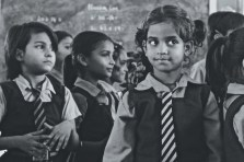 Camera shy, Taniya looks away from the lens while I conduct a photo shoot of little girls in a local government school in New Delhi, India, through an initiative with Teach For India volunteer program. Photo by Niyanta Khatri '17