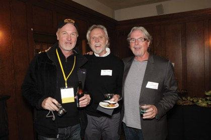 Pete Vogt '82, and CC professors Dan Tynan and Barry Sarchett enjoy catching up at the faculty meeting.