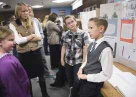 Columbine Elementary School student Kyler Coulson presents his part of the research findings while his classmate Luke Hamlow and Catamount Center Conservation & Research Director and CC MAT student Ally Ede '14 listen. After a semester of spending Fridays researching at the Catamount Center, the students had to discuss their research findings with parents and community.