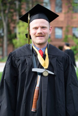 Everett Smith sports his pick to represent his degree in Geology.
