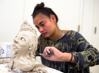 Kaila Ablao '20 adds hair to her sculpture during the Venutian Soldier Bust Sculpting workshop at the Bemis School of Art. Photo by Katie Klann