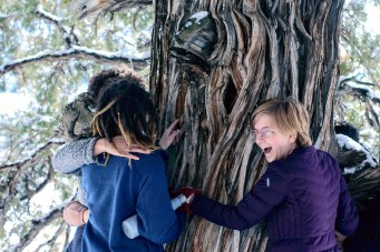 Mary Bach '21 and students who participated in a block break spiritual retreat in Crestone, Colorado, near the Baca Campus stop to hug at tree together at one of the spiritual centers they visited. Photo by Patil Khakhamian '22