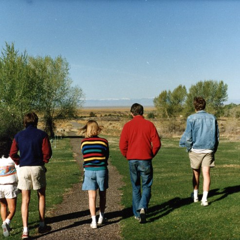 Cronin walking with students at the college's Baca campus, which he led the effort to establish and maintain.
