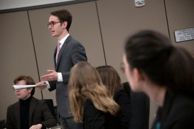 Daniel Lawrence, senior, stands up to speak on behalf of the defense during a mock trial practice on Tuesday, February 18, 2020 at the El Paso County Combined Courts. Colorado College hosts the regional mock trial tournament this weekend. (Photo by Katie Klann)