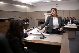 Taylor Hawkins, junior, provides a piece of evidence during a mock trial practice on Tuesday, February 18, 2020 at the El Paso County Combined Courts. Colorado College hosts the regional mock trial tournament this weekend. (Photo by Katie Klann)