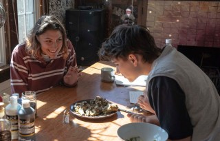 LIza Scher '22 anxiously waits while her friend Lily Epstein ' 22 smells and decides to taste test her recently culinary creation, roasted artichokes with lemon aioli. The students live in the Synergy and New Synergy houses where they experience what it is like to live in a community with others who value sustainability lifestyles.
