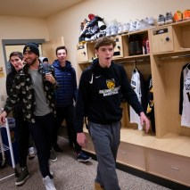 The men's basketball team walks into the locker room to see the new jerseys for the first time on Friday, February 7, 2020 at El Pomar Sports Center in Colorado Springs, Colorado. (Photo by Katie Klann)