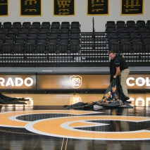 Joshua Birndorf 2/07/2020 Students and faculty file into Colorado College's Reid Arena to see the unveiling of the hew tiger logo. Everyone is excited to see how the re-deisgn looks on the court, on the scoreboard, and in the promotional video. Here, the court's new logo is unveiled.