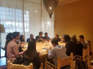 Participants eating dinner at the Airbnb headquarters