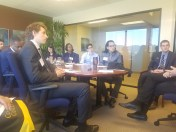 Participants in a listening session at Fairview Capital