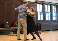 Marcia Dobson dances with her student Joel Frykholm to demonstrate a technique during a ballroom dancing classs that she teaches with her husband J.L. Riker. (Photo by Jennifer Coombes)
