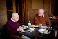 Professors Emeriti Glenn Brooks and Bill Hochman try Chipotle for the first time during a lunch on set. (Photo by Bryan Beasley)