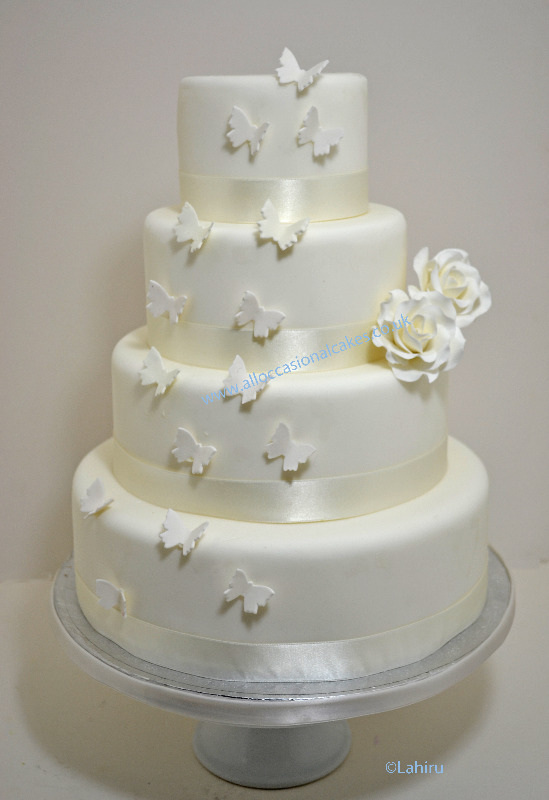 Cakes for all occasions  budget Wedding cakes  low priced wedding     Ivory Roses   Butterflys Wedding Cake  best wedding cakes  cheap wedding  cakes  special