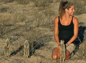 Kendra Smyth in her field site in South Africa with meerkats.