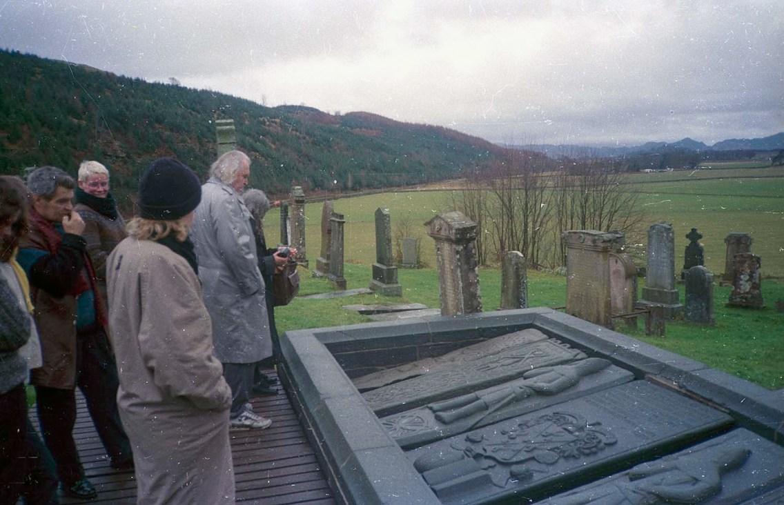 Mario Merz with medieval grave slabs at Kilmartin Churchyard, Argyll. Paul Neagu second left. Journey led by Richard Demarco; filmed by Murray Grigor