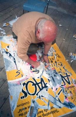 1990. Mimmo Rotella making a collage. RDG, Edinburgh.