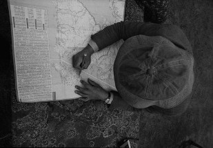 Photo by Mario 'Piccolo' Sillani Djerrahian, Richard Demarco Consults the Map, On the Road to Meikle Seggie, 1975