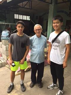 This unused area behind the church will be converted into a feeding center. In photo: Co-founders, Joshua Emmanuel Tan and Basti Belmonte with Fr. Julio Cuesta.