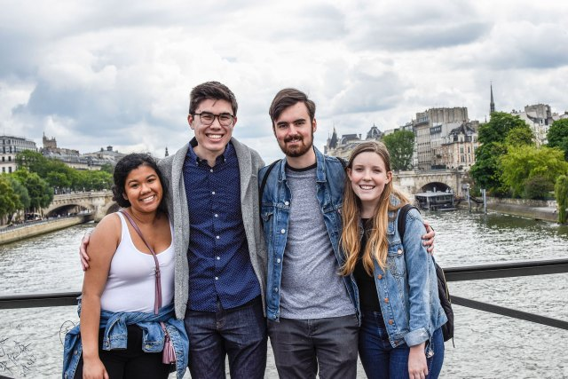 Jaden Amos, Jacob deCastro, Samuel House and Haley Klezmer pose on the Pont des Arts