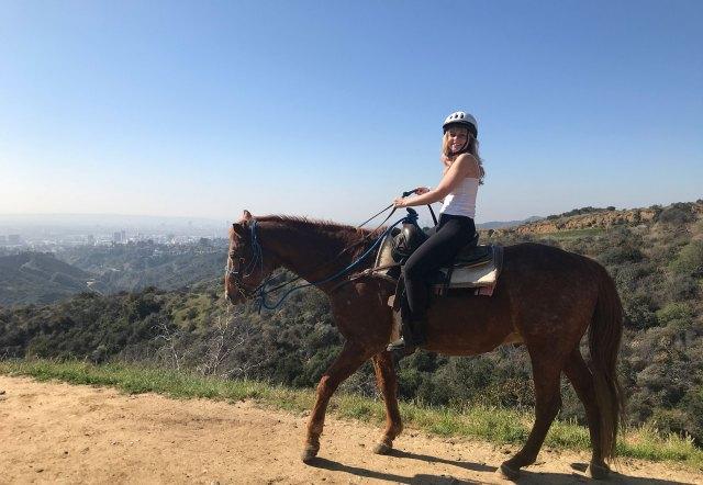 Emma Cline riding a horse