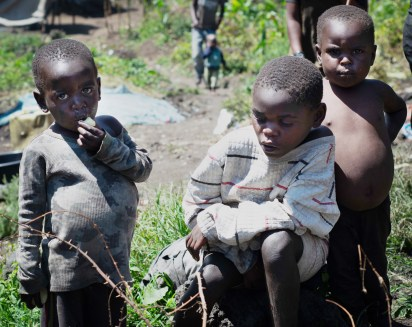 Children sit in the Mikingo Batwa Community in Kisoro, Uganda. Since being evicted from the forests years ago, the Batwa struggle with accessing healthcare.